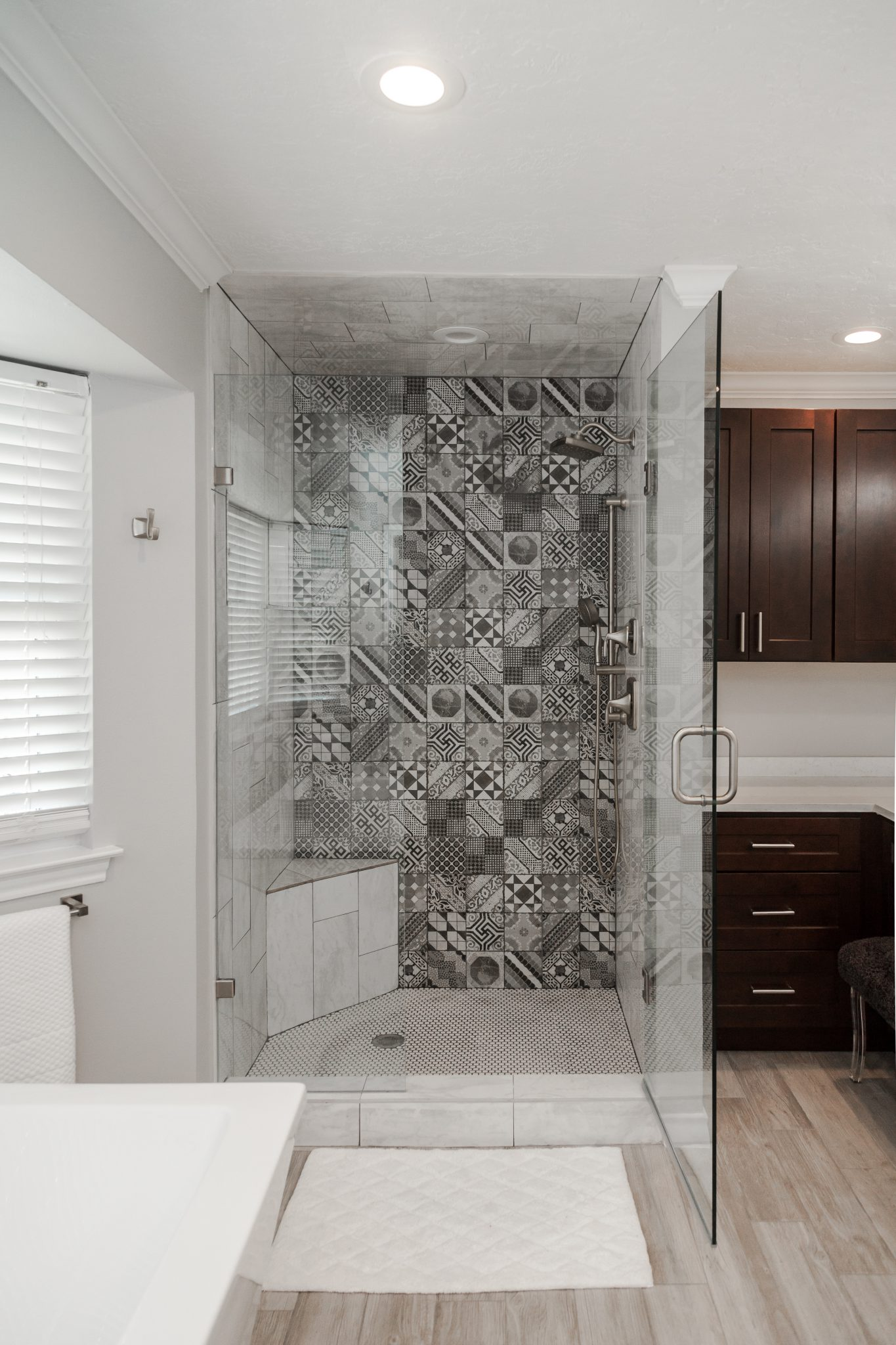Gray patterned tile shower, Castel Patchwork Gray Porcelain Tile espresso cabinets in bathroom, whitewashed wood floor